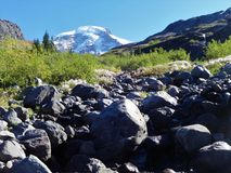 Peek a boo view of Mount Baker from Heliotrope Creek. Peek a boo view of Mount Baker from glacier fed Heliotrope Creek in Washington royalty free stock photography