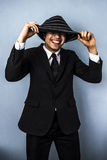 Peek-a-boo. Young multiracial businessman smiling from under his woolen hat Stock Photos