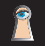 Peek through keyhole Royalty Free Stock Image
