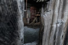Peeka-boo broom closet in mountain village. Broom closet in a mountain village on the Italian Alps royalty free stock photos