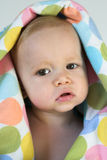 Peekaboo. Image of a cute toddler peeking out from under a colorful blanket Stock Photography