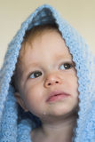 Peekaboo. Image of a cute toddler peeking out from under a blanket Stock Photography