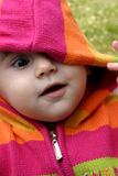 Peekaboo. Happy little baby wearing a pink hood Stock Images