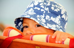 Peekaboo (cute kid hiding) Stock Images