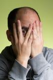 Peeking человека Стоковая Фотография