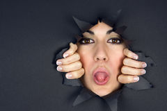 Woman Sticks Her Tongue Through Big Hole Royalty Free Stock Photography