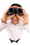 Peeking. Man holding a binocular isolated on white stock images