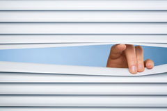 Peeking Through Blinds or Shutters Stock Images