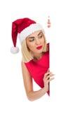 Peeking blonde santa girl Stock Image