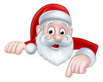 Peeking Cartoon Santa Pointing Down Royalty Free Stock Images