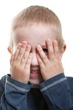 Peeking eye. Little human child hiding hand one eye fun peeking stock photos