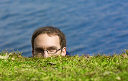 Peeking man Royalty Free Stock Photos