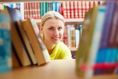 Peeking out of books Stock Image