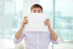 Peeking out of paper Stock Photos