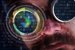 Peeking over data flows - hacking concept with futuristic man Stock Photo