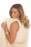 Peeking over shoulder fur vest Stock Photo