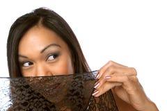 Peeking threw lace. Philippine girl peeks threw a lace umbrella Royalty Free Stock Images