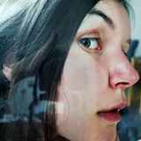 Peeking woman Stock Photo