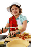 Peel Those Apples. Preteen gir cranking an apple peeler to make the filling for an apple pie Royalty Free Stock Photos