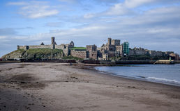 Peel Castle as seen from the beach at the entrance to Peel harbour, Isle of Man Stock Photo