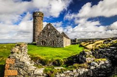 Peel Castle`s tower next to Saint Patrick`s Church constructed by vikings at Peel city in Isle of Man Stock Image