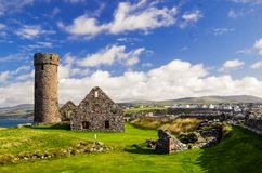 Peel Castle`s tower next to Saint Patrick`s Church constructed by vikings at Peel city in Isle of Man Stock Images