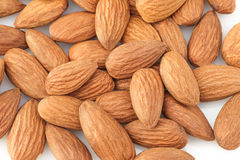 Peeled almond seed on white background. Walnut almonds on white background close-up Royalty Free Stock Images