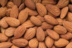 Peeled almonds close up, top view Stock Photos