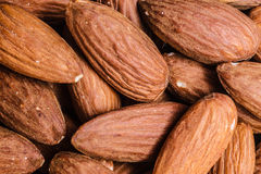 Peeled almonds closeup as background Royalty Free Stock Images