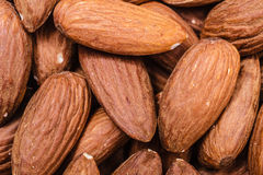 Peeled almonds closeup as background Royalty Free Stock Photo
