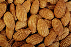 Peeled almonds closeup Stock Photography