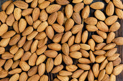 Peeled almonds closeup. On a wooden background. Nuts for vegetarians Royalty Free Stock Images