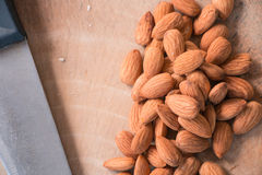 Peeled almonds closeup on wooden plate Royalty Free Stock Images