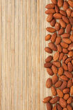 Peeled almonds lying on a bamboo mat Royalty Free Stock Photos