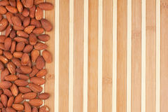 Peeled almonds lying on a bamboo mat Royalty Free Stock Image