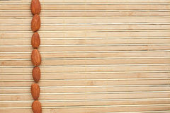 Peeled  almonds lying on a bamboo mat Stock Photography