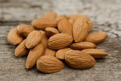 Peeled almonds on wooden background Royalty Free Stock Images