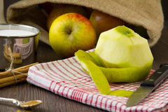 Peeled apple with ingredients for an apple pie Stock Photos