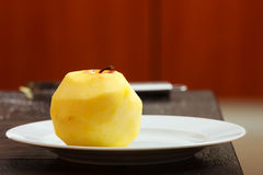 Peeled apple on plate at home. Diet nutrition. Royalty Free Stock Image