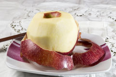 Peeled apple Royalty Free Stock Photo