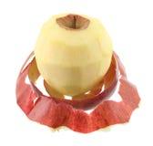 Peeled apple Stock Images