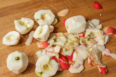 Peeled apples and peel Royalty Free Stock Image