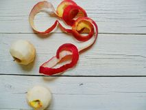 Peeled apples on the white boards Stock Photography