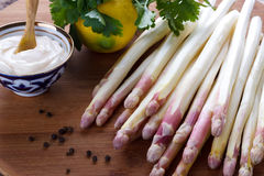 Peeled asparagus on a board Royalty Free Stock Images