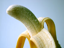 Peeled banana. Close-up Stock Images