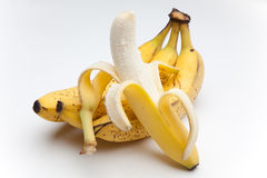 Peeled banana. A bunch of bananas on a white background Stock Photos