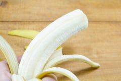 Peeled banana and banana skin Royalty Free Stock Photos