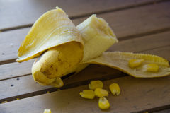 Peeled banana and Seed corn. Royalty Free Stock Photography