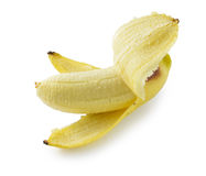 Peeled banana standing straight, isolated on white with shadow Royalty Free Stock Photo