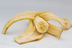 Peeled banana on white background Royalty Free Stock Photography